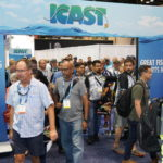 Attendees enter the show floor on opening day
