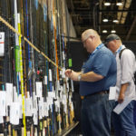 Inspecting rods at New Product Showcase