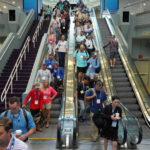 ICAST attendees coming down the escalators