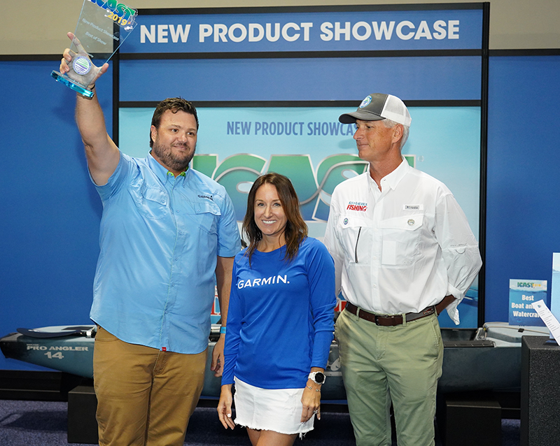ASA President Glenn Hughes congratulates Garmin on winning Best of Show